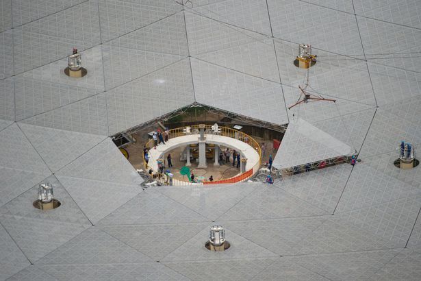 The last triangular panel to the reflector of Aperture Spherical Telescope is installed